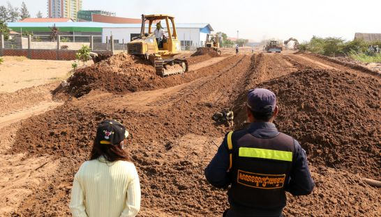 Overseas Cambodia Investment Corporation uses bulldozers to clear land on Phnom Penh's Chroy Changvar peninsula yesterday.