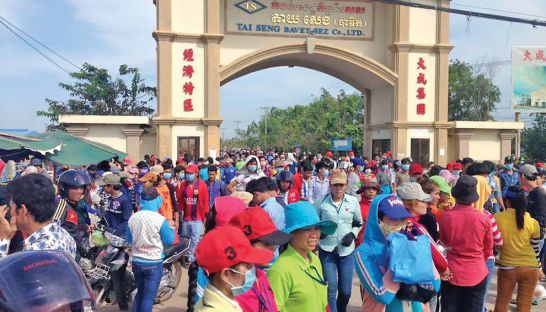 Garment workers pour out of the Tai Seng Bavet SEZ earlier this week in Svay Rieng province during a large protest, calling for a higher minimum wage for the industry.