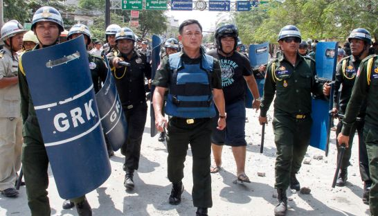 Rath Sreang (centre), chief of the Phnom Penh military police, leads subordinates along a road in the capital's Meanchey district in 2013 during a violent crackdown on protesting garment workers.