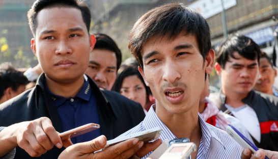 Srey Chamroeun, leader of a student group, talks to the media last week outside the National Assembly before filing a complaint against opposition deputy leader Kem Sokha with the ACU.