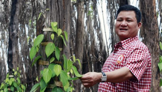 Try Pheap poses for a photograph earlier this year at one of his economic land concessions in Preah Vihear
