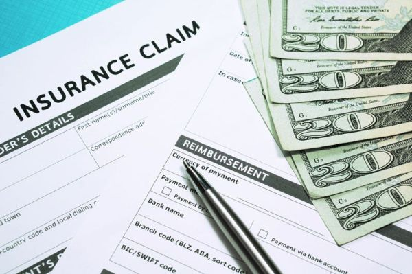 insurance claim form next to cash