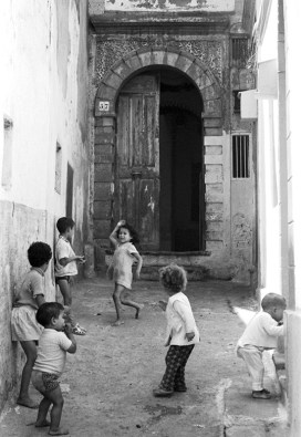 Life – Moroccan children dancing in courtyard