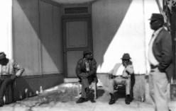 Life – men sit in stark city doorway