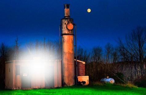 a gas powered well site is illuminated by electric and moon light