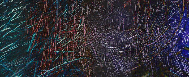 Abstract – swirls of color streak on dark background