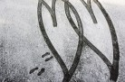 Conceptual – tire tracks in snow form intertwined hearts - fart