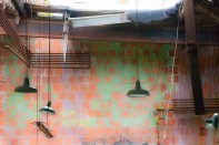 Man-made – light fixtures hang against colorful wall tiles in an abandoned derelict room