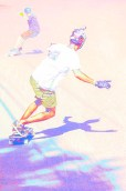 Graphic – skateboarders leaning into their turns