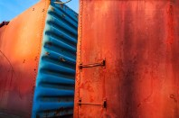 Graphic – orange and blue train boxcars