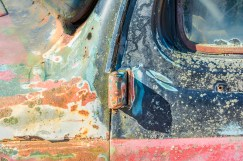 Graphic – Layers of colorful peeling paint on a vintage automobile