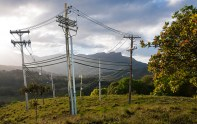 Fantasy – ring of seven electric utility poles on lush mountain top