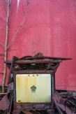 Man-Made – small Hardwick 1920's stove in front of a barn-red background