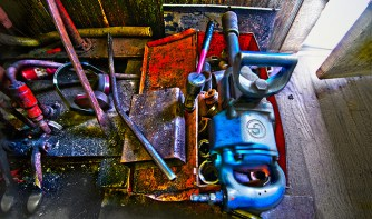 Man-made – brightly colored tools strewn on dirty floor