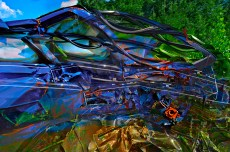 Abstract – crumpled blue junkyard car with crooked white pin striping