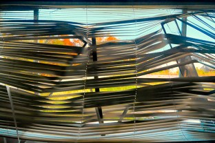 Man-Made – view outside through bent Venetian blinds - fart