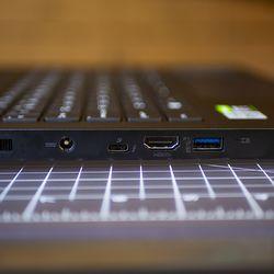 <em>The left side's ports include a barrel charging port, Thunderbolt 3, HDMI, and USB Type-A 3.12 Gen 2 port.</em>