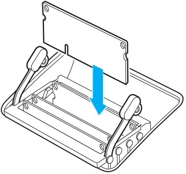 Installing a memory card into the memory cage on a Mac