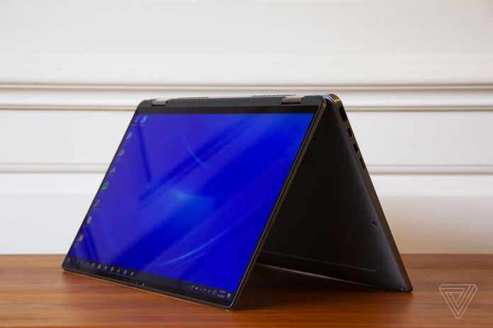 The Dell Latitude 9510 2-in-1 angled to the left in tent mode.