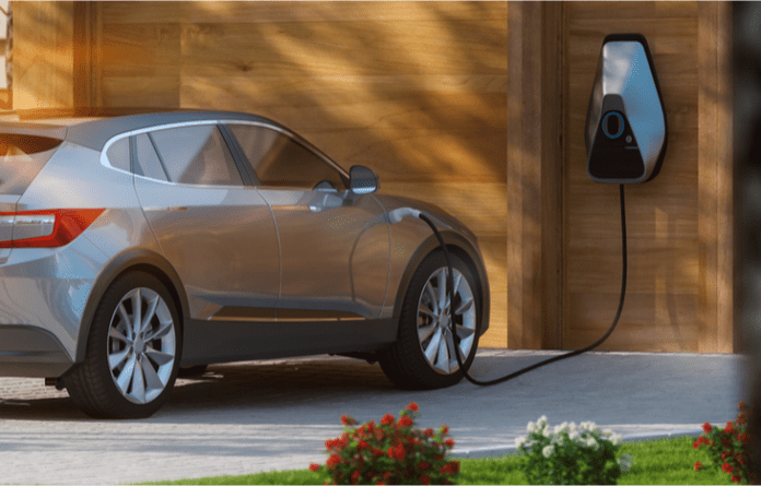 an electric car plugged in shows growing demand for ev stocks