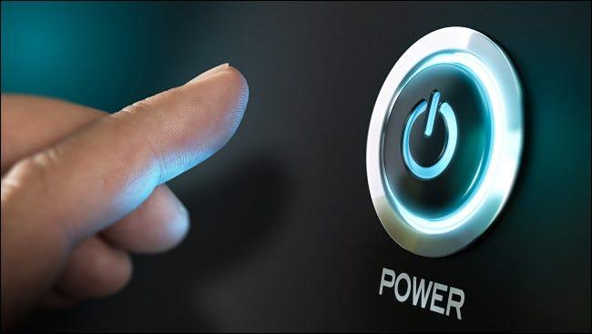 Finger pushing power button.