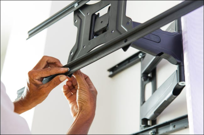 Setting up a TV wall mount.