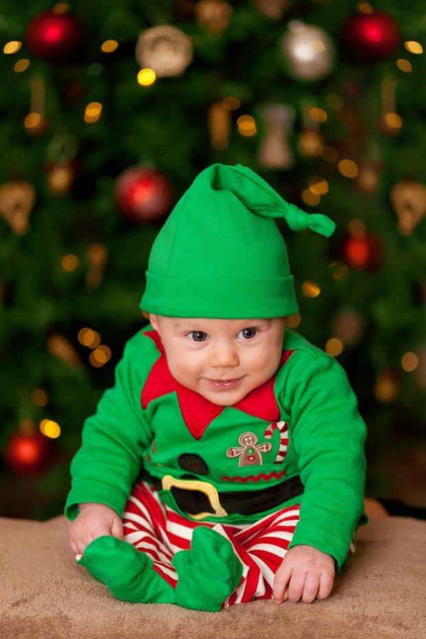 baby near christmas tree