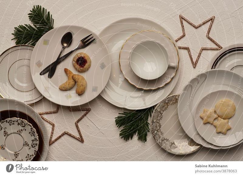 various plates with pastries and christmas decoration a royalty free stock photo from photocase