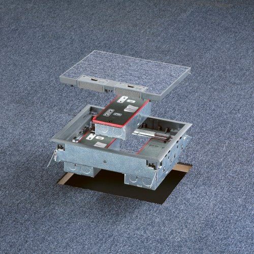 Exploded shot of floor box in office situation grey carpet tiles electrical photography