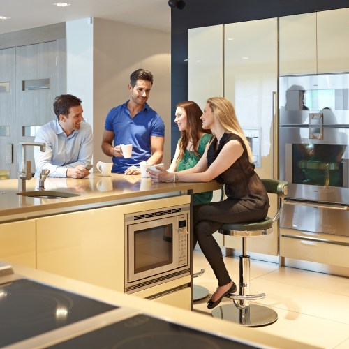 Group of young professionals having a coffee in modern contemporary kitchen - People photography