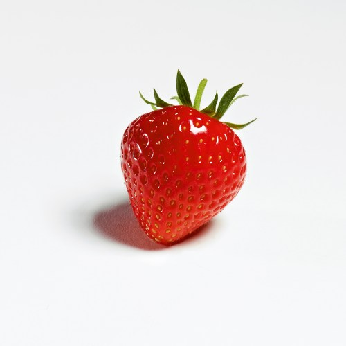 Single strawberry on white background - Food and drink photography