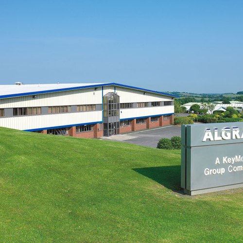 Exterior shot of large Factory warehouse with signage - Exterior/Location photography