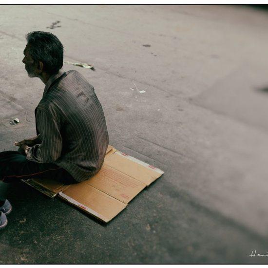 a homeless man in kolkata at a station