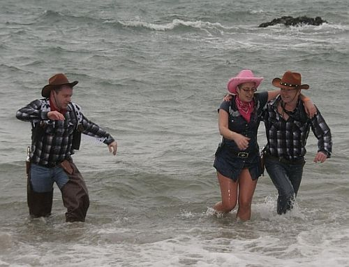 Even cowgirls go for the charity swim