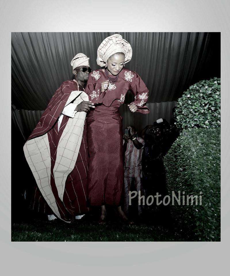 bride & groom in traditional attire dancing