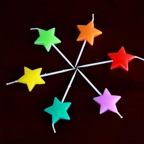 A picture of six star candles in various different colours