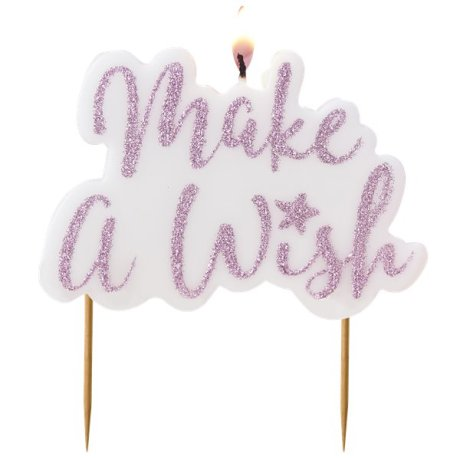 a photo of a cake candle showing make a wish written in pink glitter
