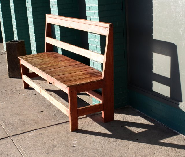 Wooden Bench In The Sunlight