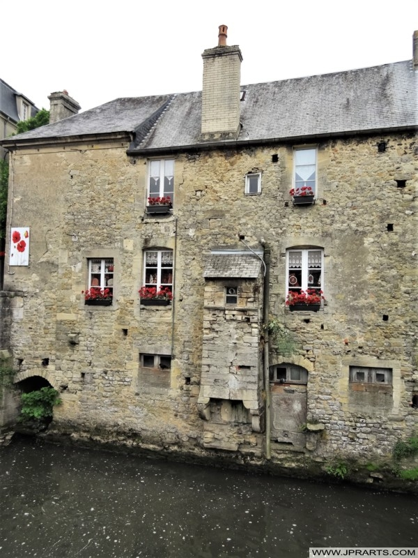 Old Stone Building on the River Aure in the former Tanning District of Bayeux, France