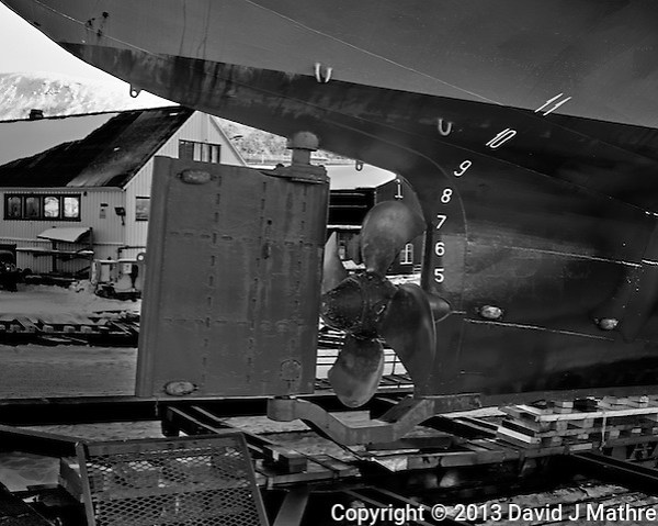 Aft rudder and screw on the Stallovarre. A passenger/Ro-Ro cargo ship being winched into a dry dock in Tromsø, Norway. Image taken with a Leica X2 camera (ISO 100, 24 mm, f/5.6, 1/50 sec). Raw image processed with Capture One Pro (including conversion to B&W). (David J Mathre)