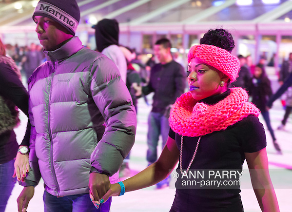 Manhattan, NY, USA. Nov. 9, 2013. Bryant Park's colorful ice skating rink is filled with people skating and talking with friends. (© 2018 Ann Parry/Ann-Parry.com)