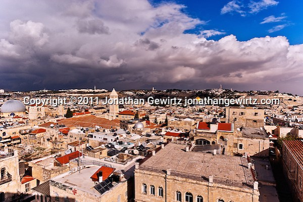 Skyline of the Old City of Jerusalem as seen from the Tower of David against a backdrop of winter storm clouds. (Jonathan Gewirtz)