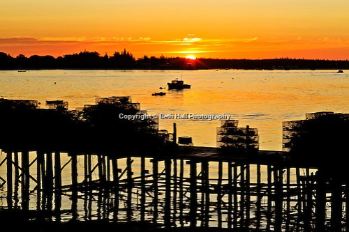 Lobster boats are silhouetted in the bay at sunrise. (Beth Hall)