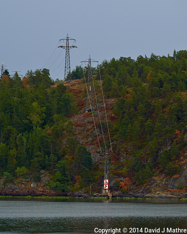 Power Lines into the Water. Departing Stockholm, Sweden. Semester at Sea, Summer 2014 Voyage. Image taken with a Nikon Df camera and 70-200 mm f/4 VRII lens (ISO 400, 200 mm, f/5.6, 1/125 sec). Raw image processed with Capture One Pro, Focus Magic, and Photoshop CC 2014. (David J Mathre)