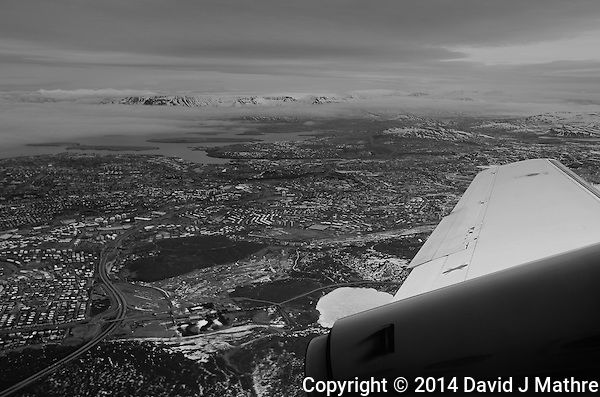 Aerial View of Reykjavik from and Eagle Air Plane. Image taken with a Leica X2 (ISO 100, 24 mm, f/5, 1/250 sec). Raw image processed with Capture One Pro, and Focus Magic. (David J Mathre)