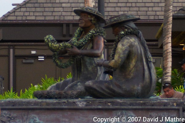 "Kona International Airport Waiting Area. Bronze of ""The Lei Makers"" Image taken with a Nikon D300 and 28-70 mm f/2.8 lens (ISO 560, 45 mm, f/2.8, 1/60 sec). Image cropped. (David J Mathre)"