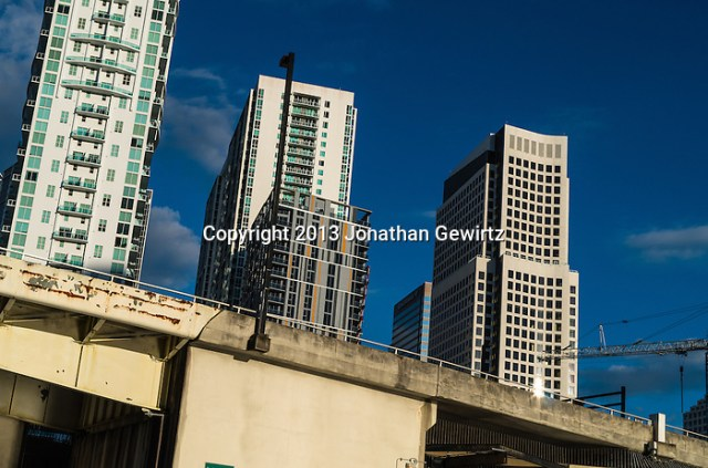 In an optical illusion, high rise buildings appear to slide down a bridge in downtown Miami, Florida. (Jonathan.Gewirtz@gmail.com)