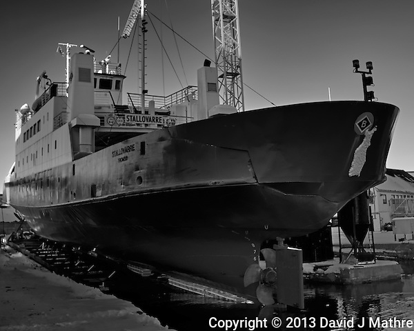 Stallovarre -- passenger/Ro-Ro cargo ship being winched into a dry dock in Tromsø, Norway. Image taken with a Leica X2 camera (ISO 100, 24 mm, f/5.6, 1/50 sec). Raw image processed with Capture One Pro (including conversion to B&W). (David J Mathre)