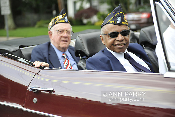 American Legionnaires, Booker T. Gibson at right, riding in classic car in Merrick Memorial Day Parade on May 28, 2012, on Long Island, New York, USA. America's war heroes are honored on this National Holiday. (Ann Parry/Ann Parry, ann-parry.com)
