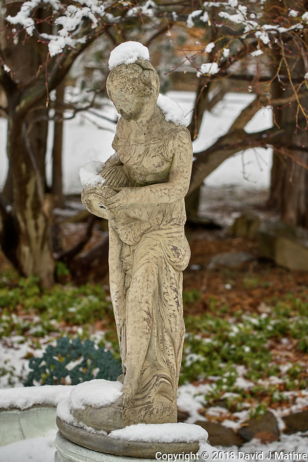 Birdbath statue with snow in April -- Winter is not gone. Image taken with a Leica TL2 camera and 60 mm f/2.8 lens (ISO 100, 60 mm, f/3.5, 1/160 sec). (David J Mathre)